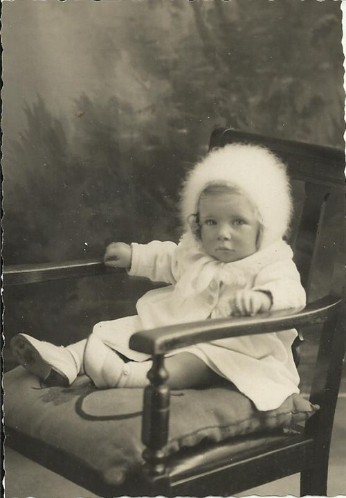 Ann aged 1 with fluffy white hood.jpg