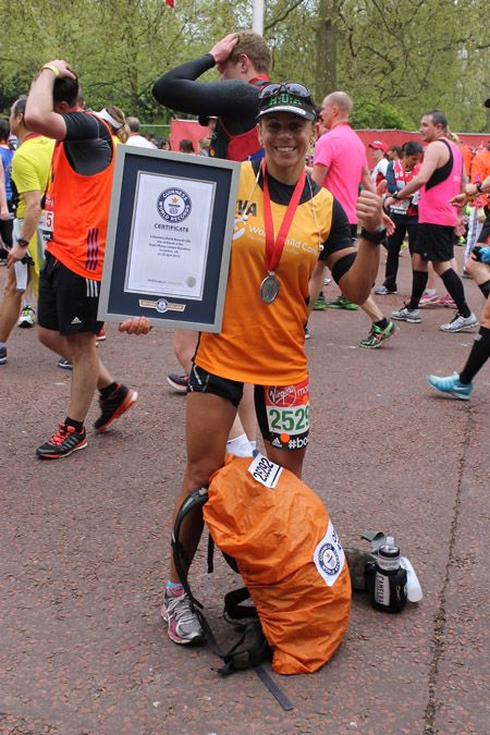 Fastest marathon carrying a 40-lb pack (female)
