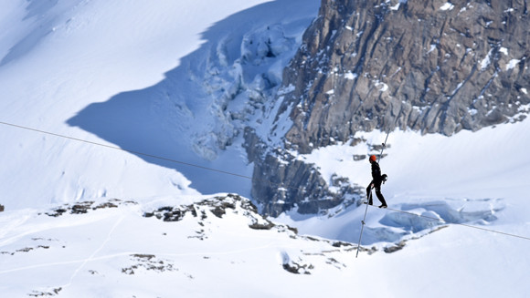 Daredevil Freddy Nock breaks 30-year-old highest tightrope record with walk across Swiss peaks