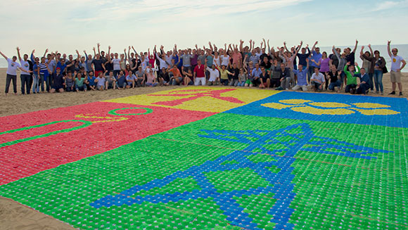 RWE Consulting employees create largest drink umbrella mosaic at team-building event in Netherlands