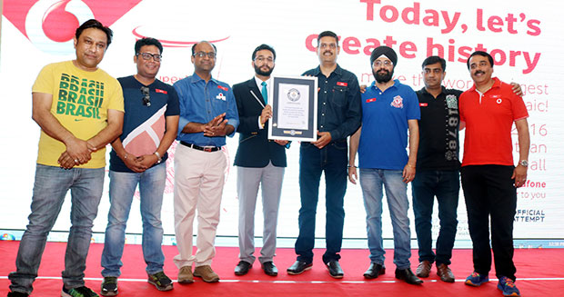 Largest disposable cup mosaic Vodafone certificate presentation