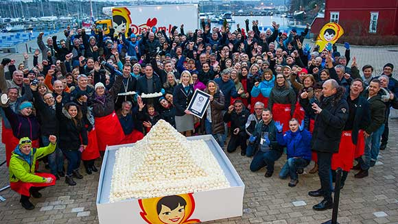 Employees of Norwegian dairy company build world's largest ice-cream scoop pyramid at teambuilding event