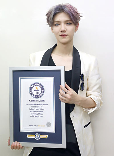 LuHan with certificate for largest gathering of people wearing antlers