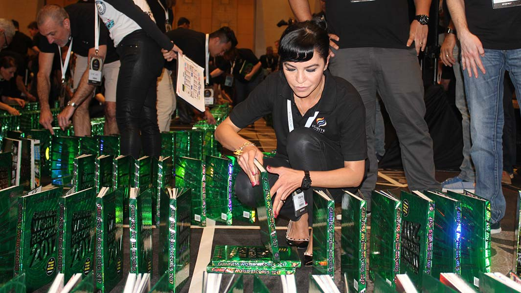 Aussie tech company topples book dominoes record for team-building challenge