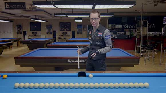 Record holder tutorial: Pool trick shot pro Florian Kohler shows you how to execute a jump shot