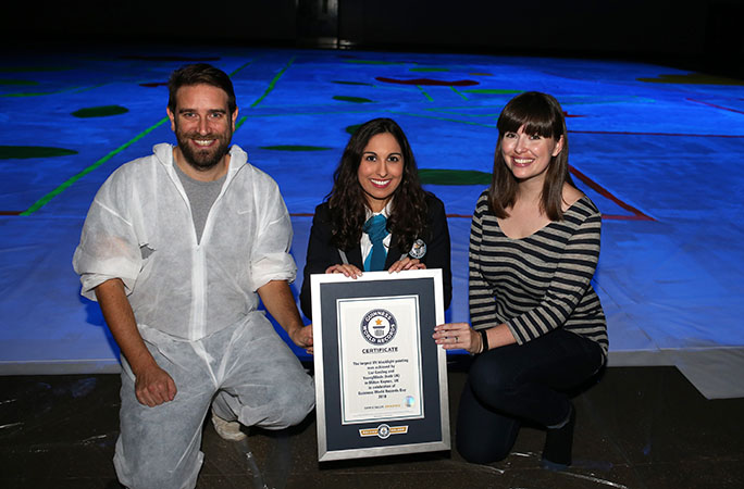 From left: Tom Madders, Director of Communications & Campaigns at YoungMinds, Guinness World Records adjudicator Shantha Chinniah, Artist Livi Gosling