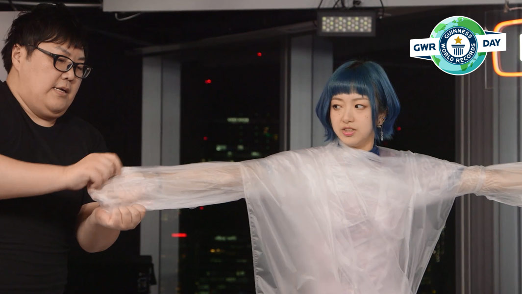 Japanese YouTuber Dekakin sets a new record for the fastest time to wrap a person in cling film