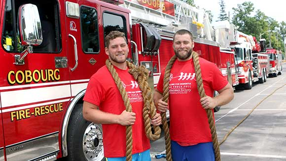 Watch Canadian brothers haul three fire engines in bid to break father's record