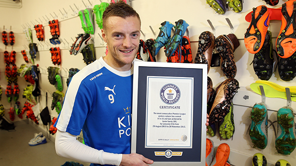 Leicester City striker Jamie Vardy is presented with GWR certificate in honour of his record goal-scoring run