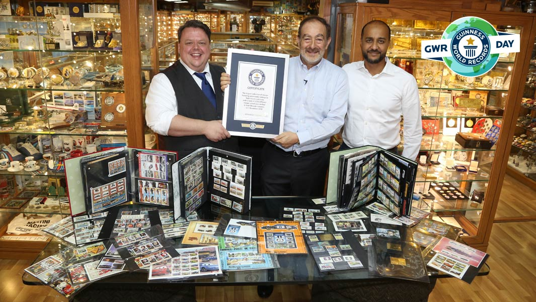 Guinness World Records editor-in-chief Craig Glenday presents Billy Karam with his certificate for the largest collection of stamps featuring automobiles