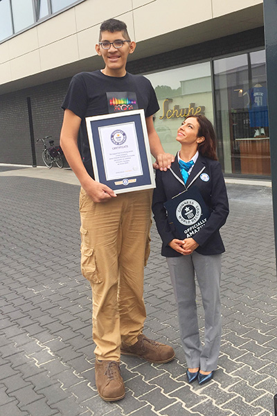 Largest feet record holder Jeison with GWR adjudicator Lucia