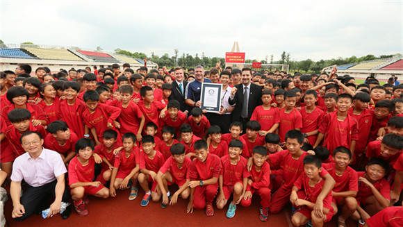 Chinese soccer school with over 2,000 students earns world record title for largest residential football academy