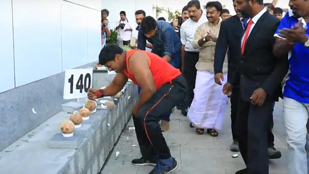 Indian man smashes his way to new record by breaking open coconuts with his hand