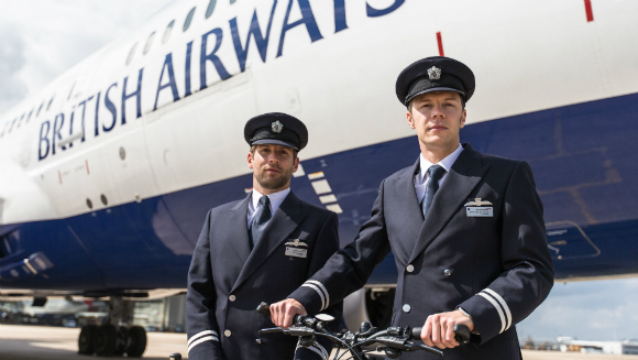 British Airways pilots make history on two wheels by setting record for most countries visited by bicycle in 24 hours - video