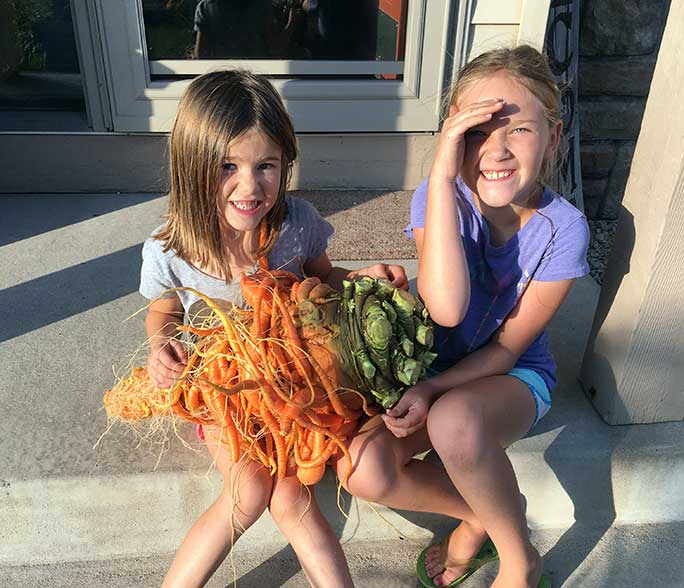 Chris's daughters holding the record-breaking carrot