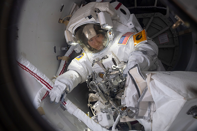 Christina-Koch-preparing-to-exit-Quest-airlock-to-space