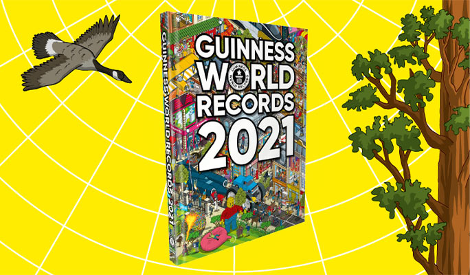 Guinness World Records 2021 book with illustration of plover to the left and the tallest tree to the right on bright yellow background