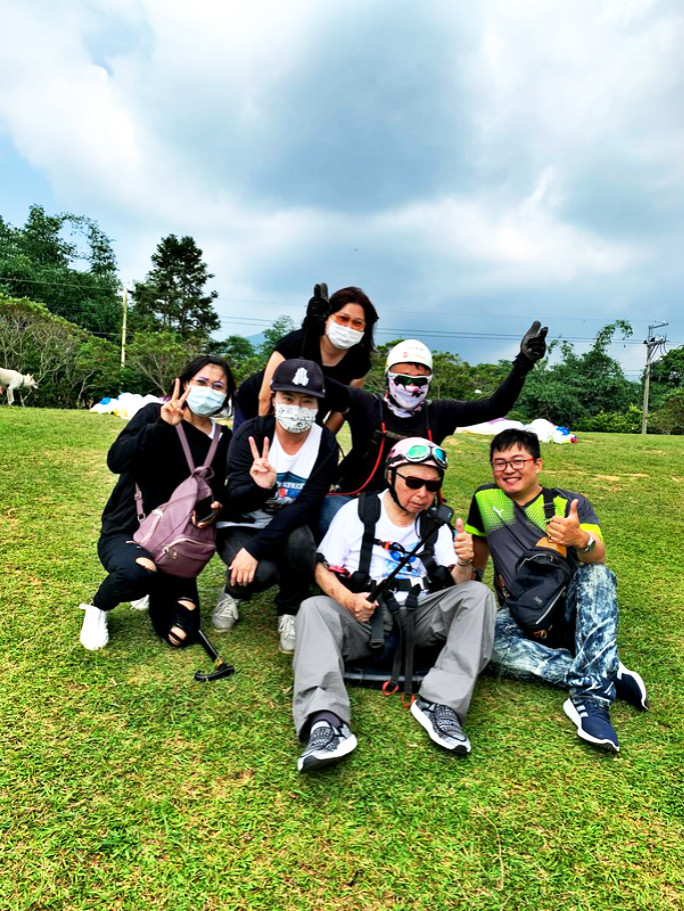 Oldest person to tandem paraglide with coaches and family
