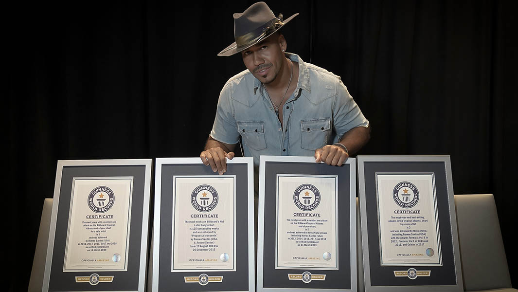 Latin artist Romeo Santos presented with four Billboard Guinness World Records titles