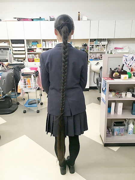 The longest hair on a teenager in braids