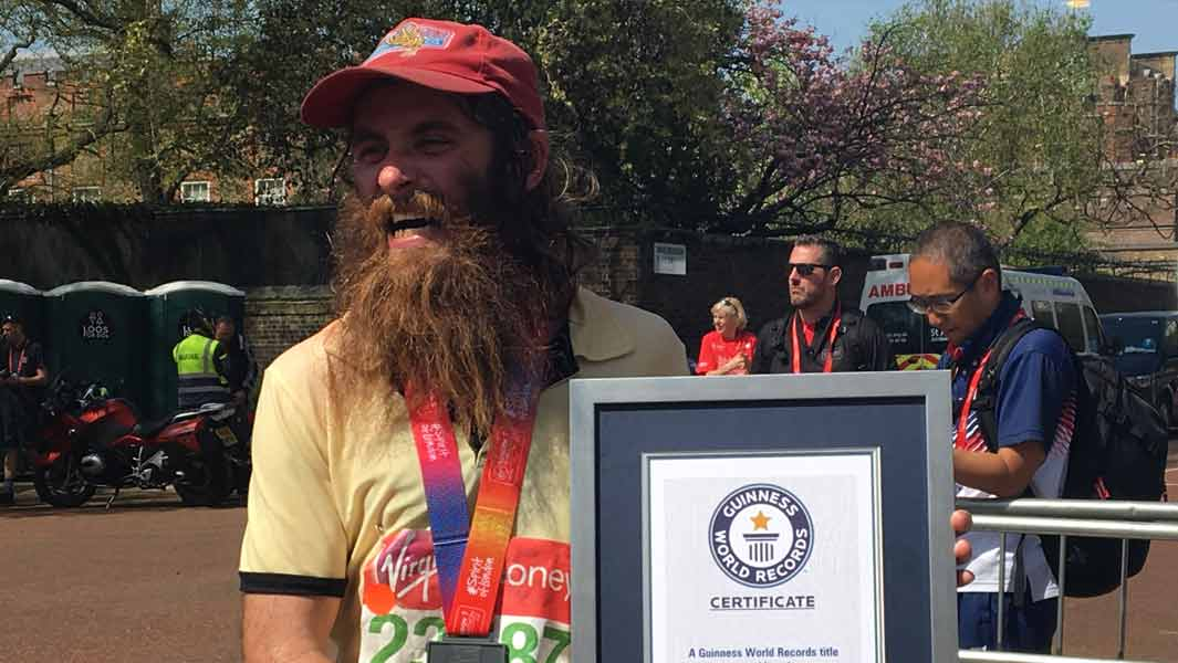 Man dressed as Forrest Gump leads home 34 record breakers at Virgin Money London Marathon