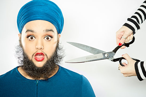 Youngest female with a full beard scissors