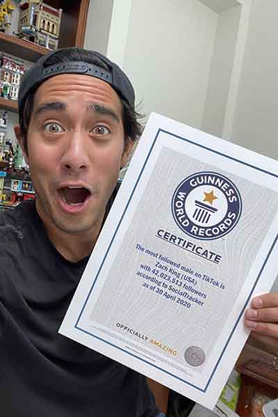 Zach-King-holding-his-certificate-very-excited