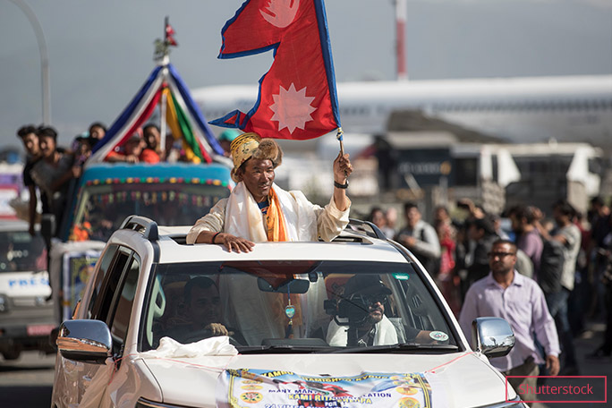 Flying the Nepali flag during a procession in the country's capital, after his 24th ascent of Everest