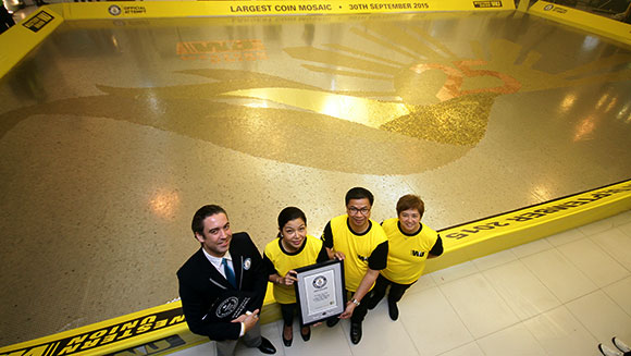 Western Union celebrates anniversary by creating huge coin mosaic