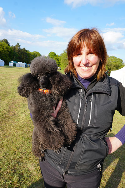 Lynne Land and her poodle Freddie achieved the record for fastest 30-m recall at DogFest Knebworth