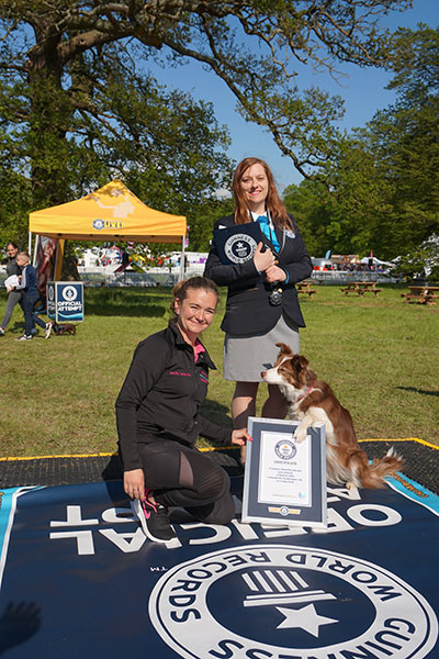 Adjudicator Sheila with sitting champion Nala and her owner, Nicci