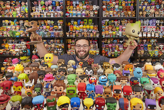 paul-scardino-holding-up-his-funko-pop-collection