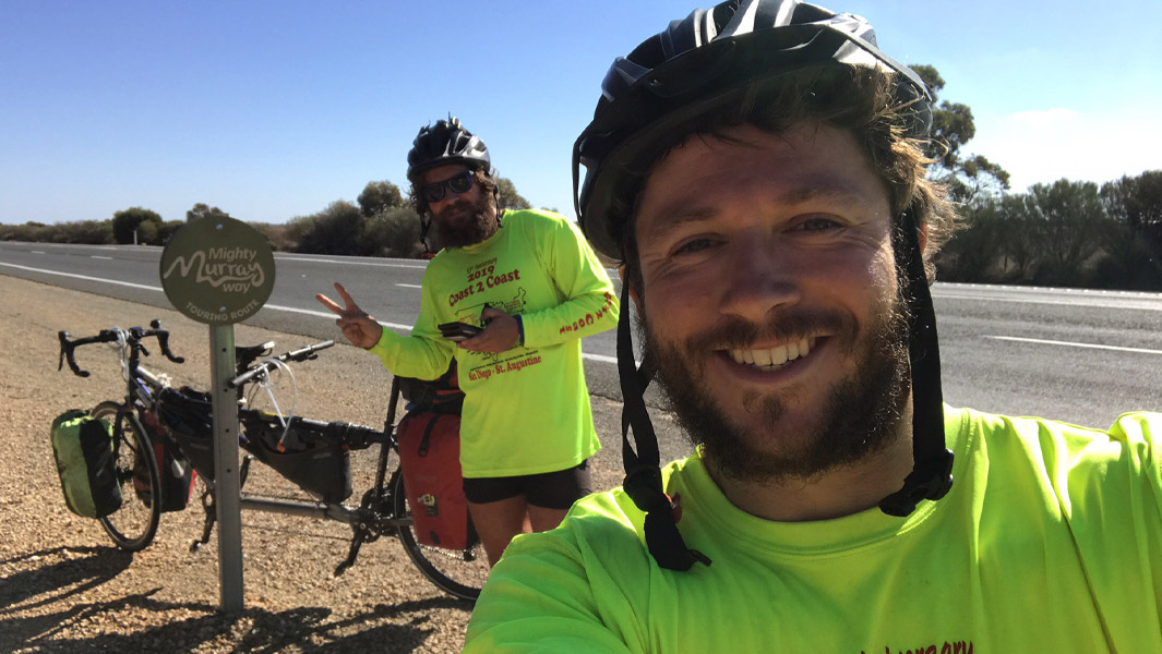 Doctors pedal more than 28,000 km to circumnavigate the globe on a tandem