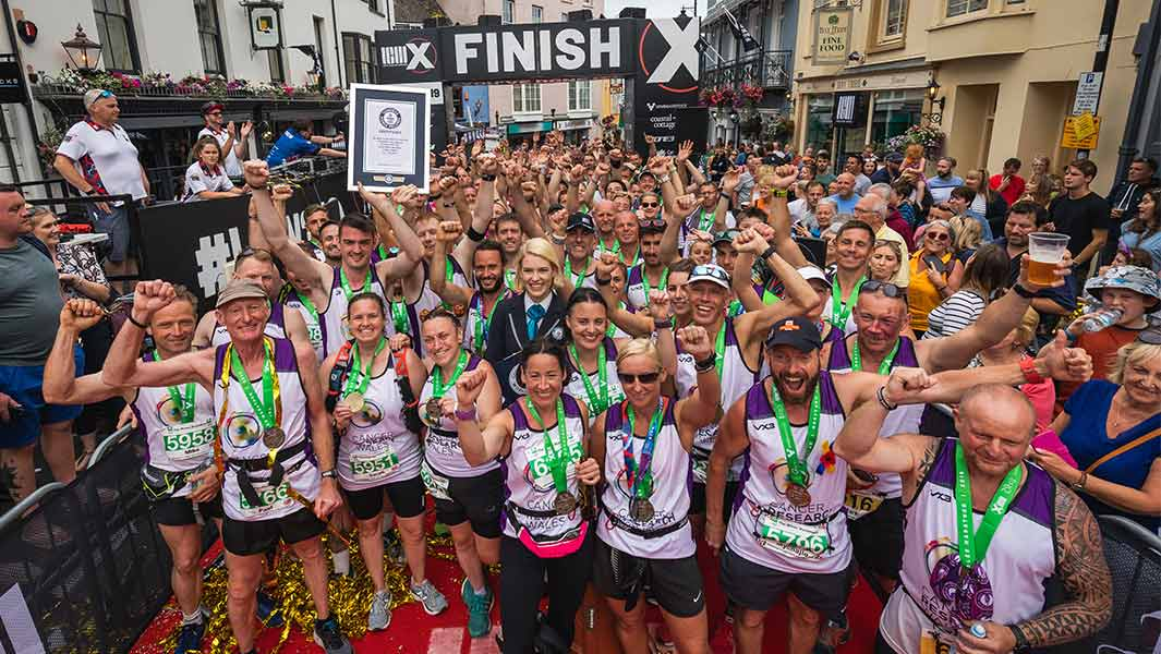 122 people run marathon linked together to raise money for Cancer Research Wales