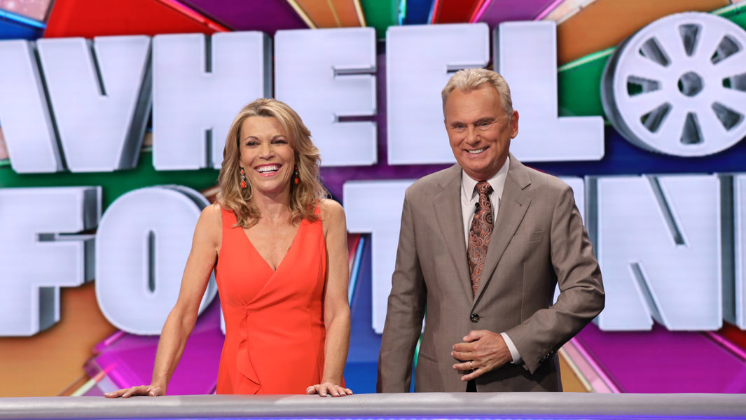 Wheel of Fortune presenters Vanna White and Pat Sajak