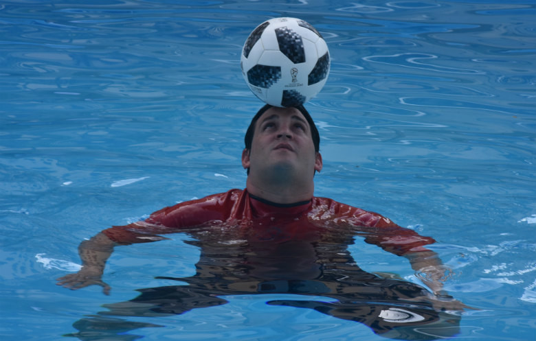Longest time treading water whilst balancing a football on the head