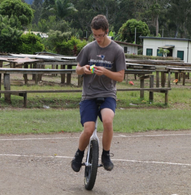 Most Rubik's cubes solved on a unicycle